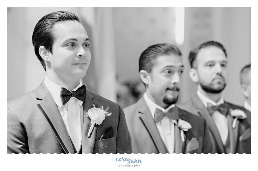 Groom seeing bride for the first time at wedding ceremony