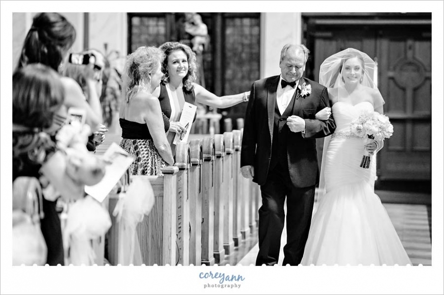 Bride being escorted down the aisle by her father in Tremont Ohio