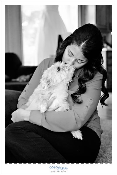 Bride kissing her dog before wedding ceremony in akron ohio