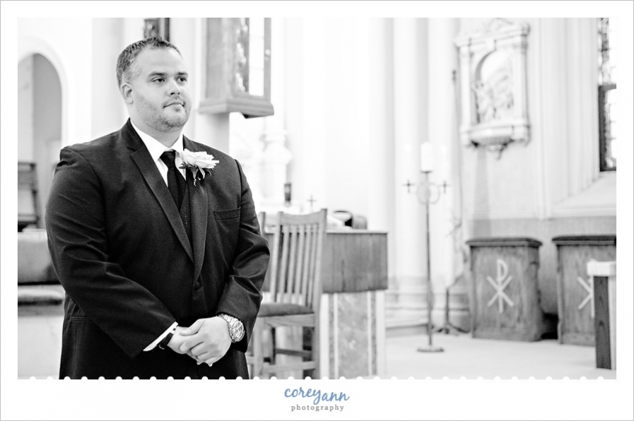 groom seeing bride coming down the aisle at wedding ceremony