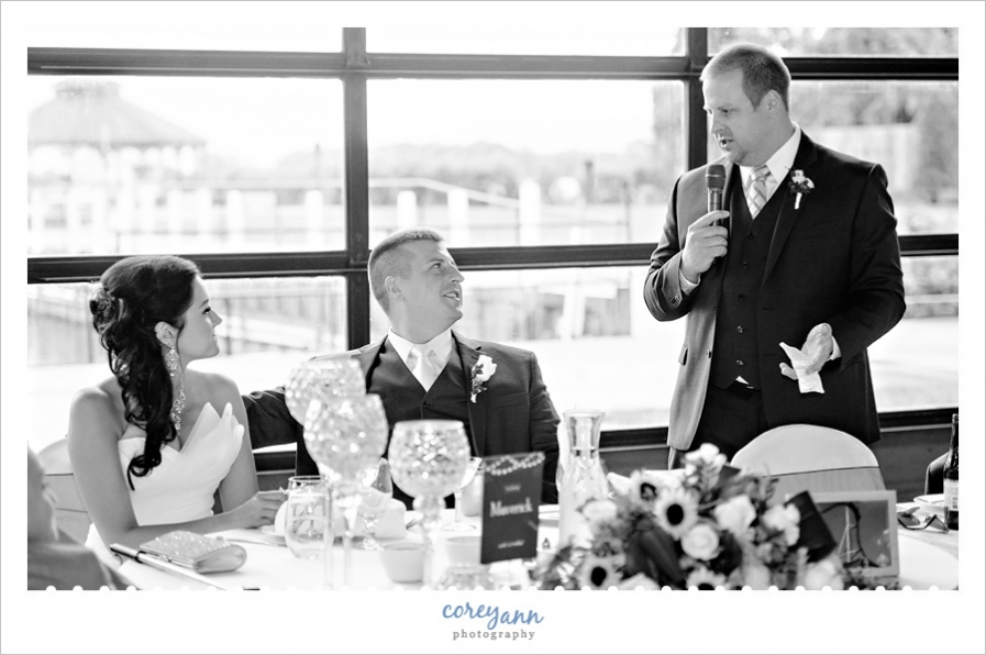 toasts during wedding reception at Lyman Harbor
