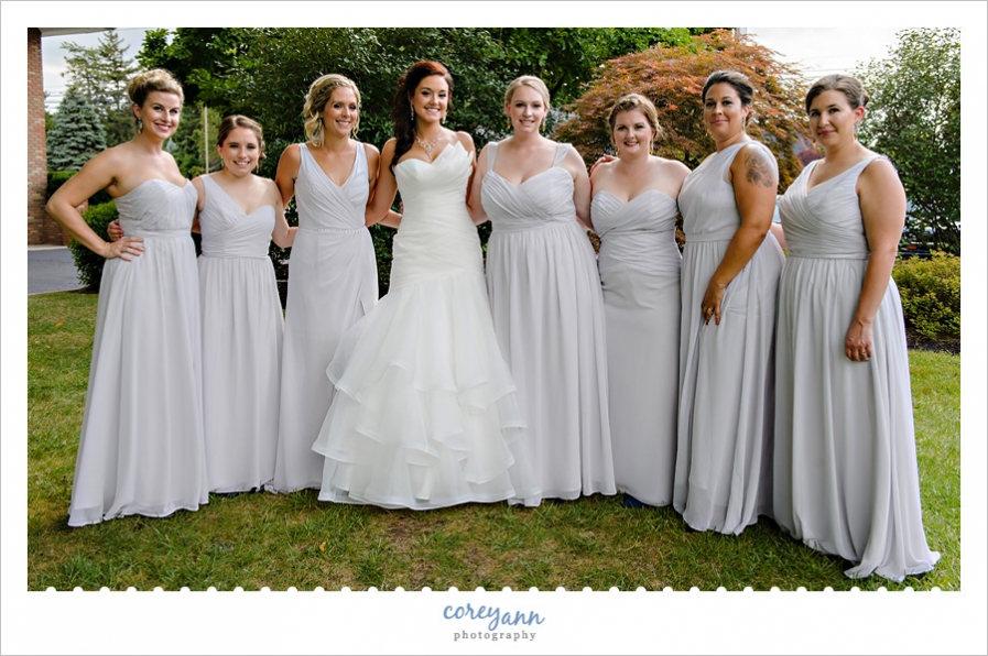 bridesmaids in different grey gowns