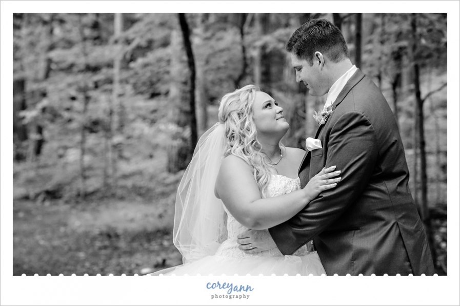bride and groom at brecksville reservation for wedding photos