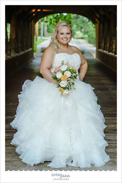 Bride posing at covered bridge in olmsted falls