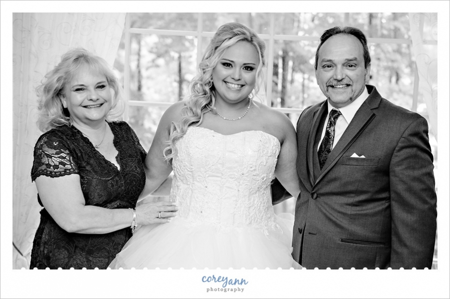 black and white portrait of bride with parents