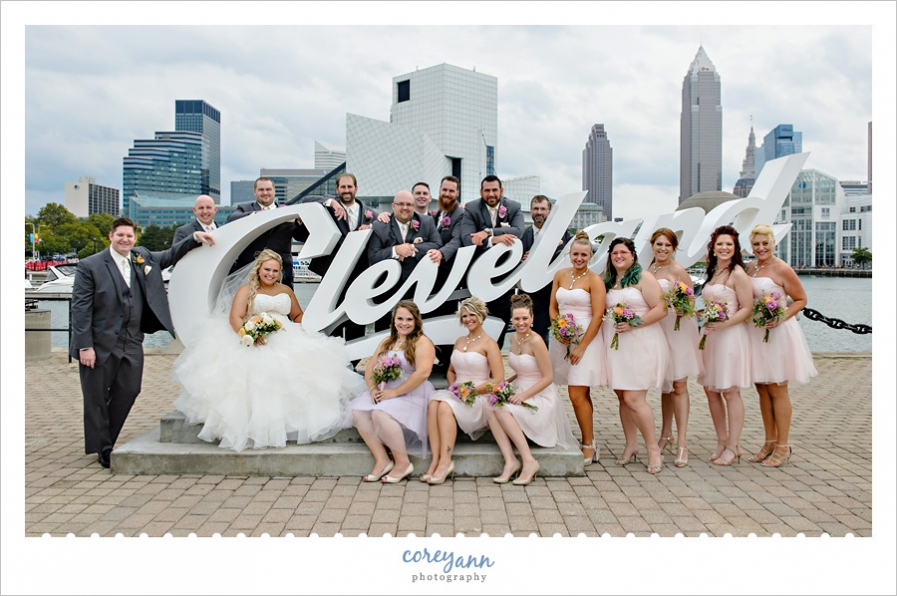 bridal party posing at the Cleveland sign downtown