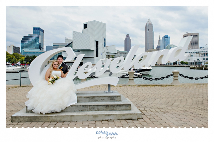 Bride and groom at the cleveland script sign in downtown