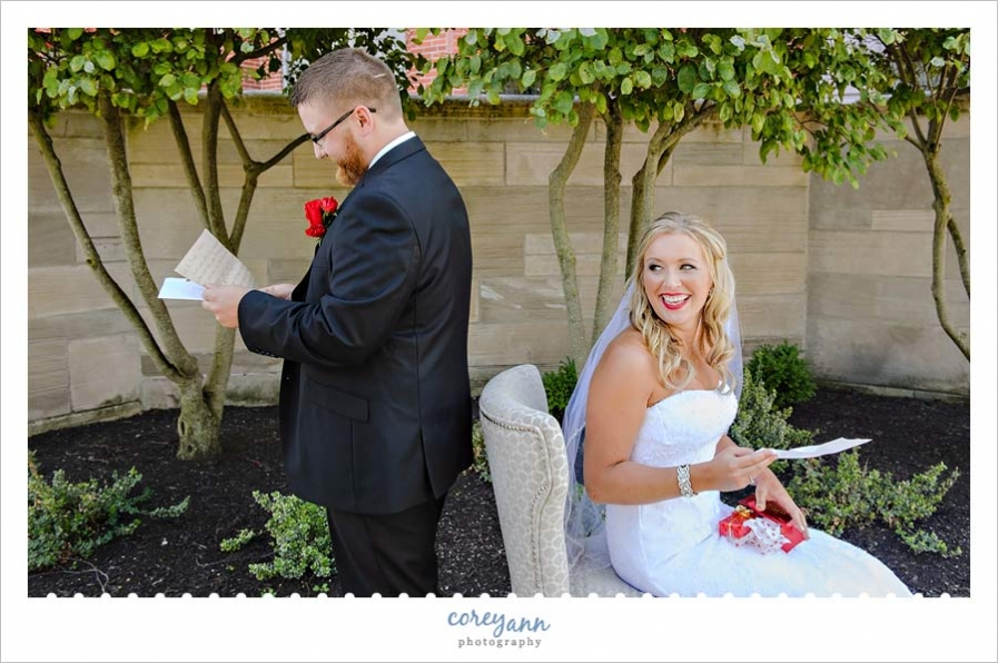 Bride and Groom reading letters they wrote