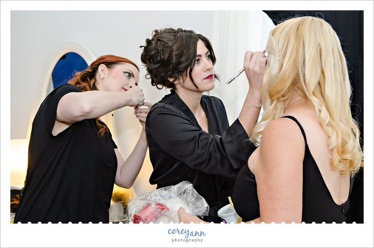 bride and maids doing makeup before the wedding in louisville