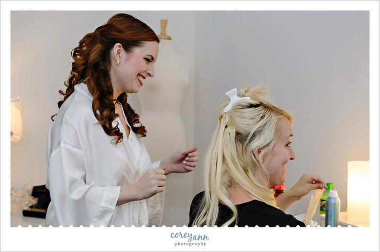 bride and sister before wedding getting ready