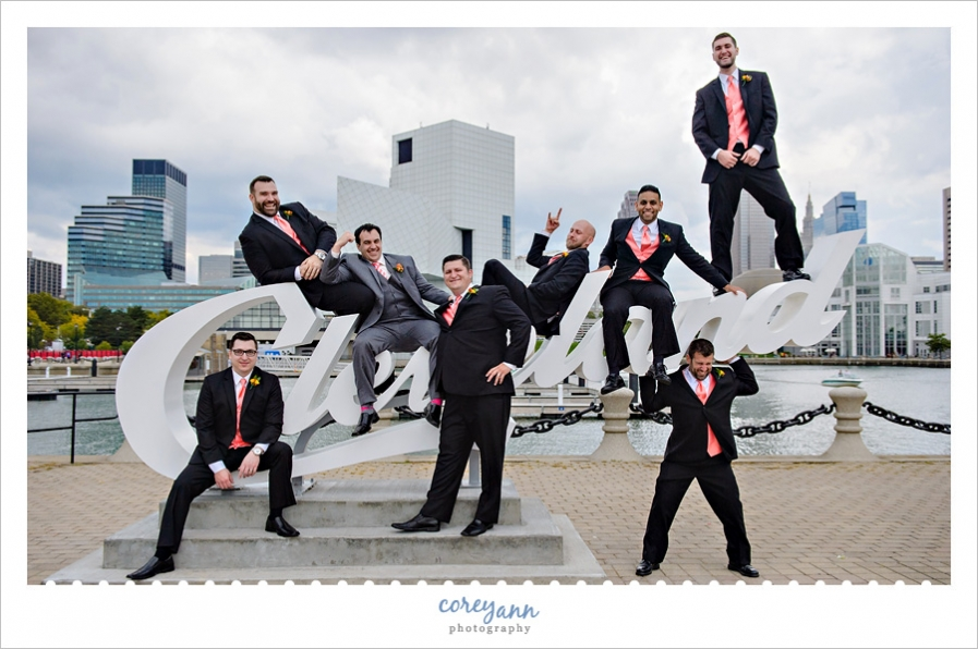 groomsman posing on the cleveland script sign in downtown cleveland