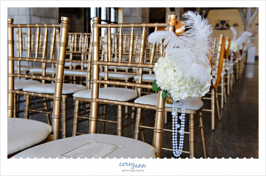 Ostrich feather and floral aisle decorations