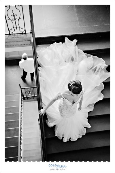Bride walking down stairs to first look