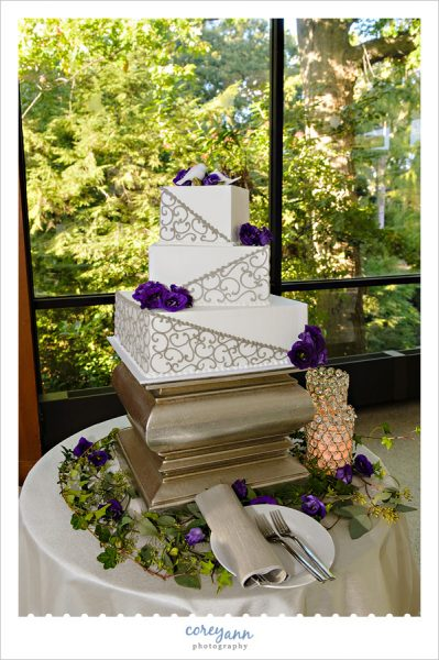 purple and silver square wedding cake by wild flour bakery