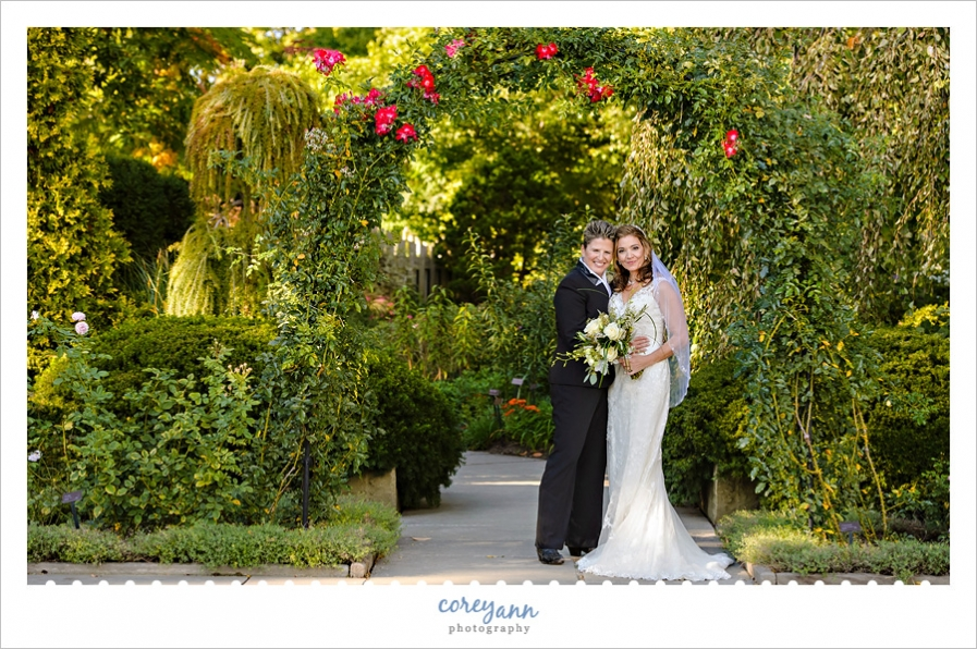 classic wedding portrait beneath arbor at cleveland botanical gardens