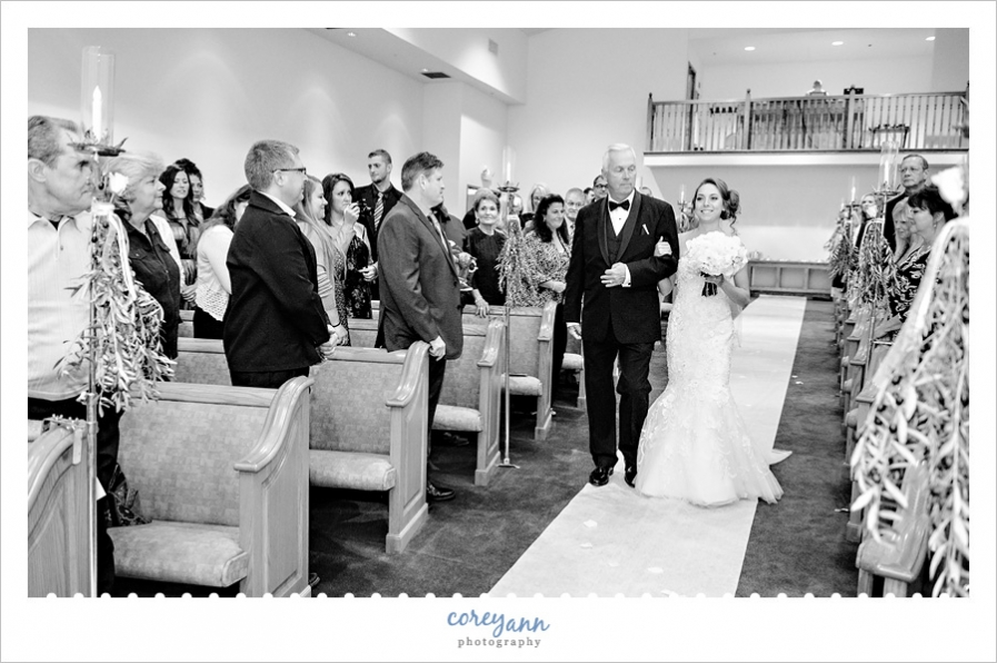 Bride walking down aisle at Louisville Church of Christ