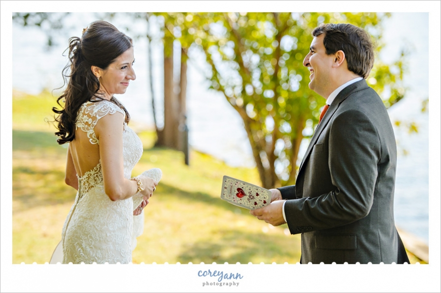 Groom reading card from Bride before wedding ceremony