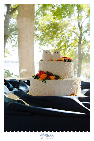 White wedding cake with owl toppers