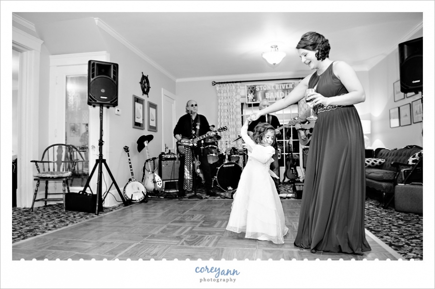 Flower Girl dancing on the dance floor at the wedding reception