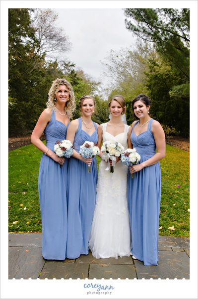 Bride and Bridesmaids in long blue gowns