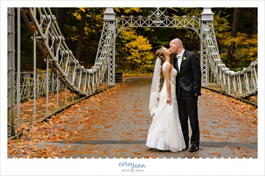 Bride and Groom kissing on Cinderella Bridge in Youngstown