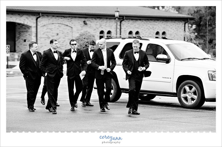 groom and groomsman walking into church in canfield ohio