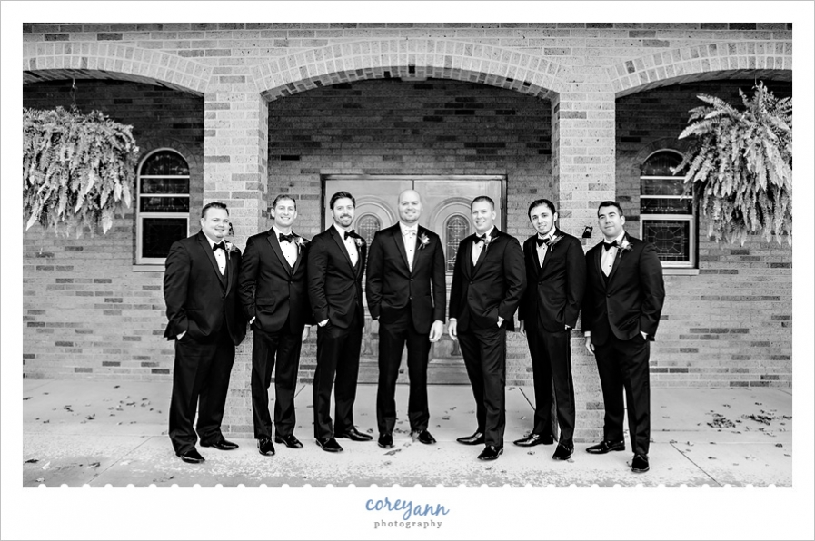 Groom and Groomsman outside of St Michael Church