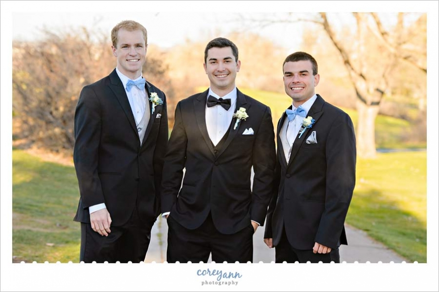 Groom and Groomsman in tuxes for November wedding