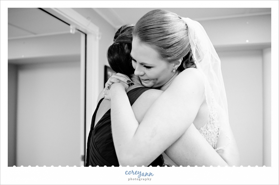 Bride hugging Mom after getting dressed