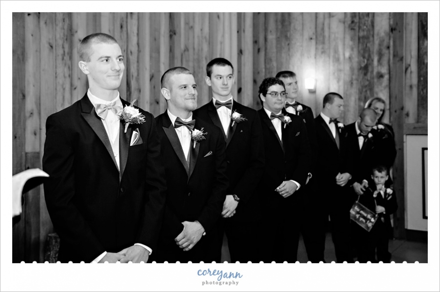 Groom seeing bride at wedding ceremony
