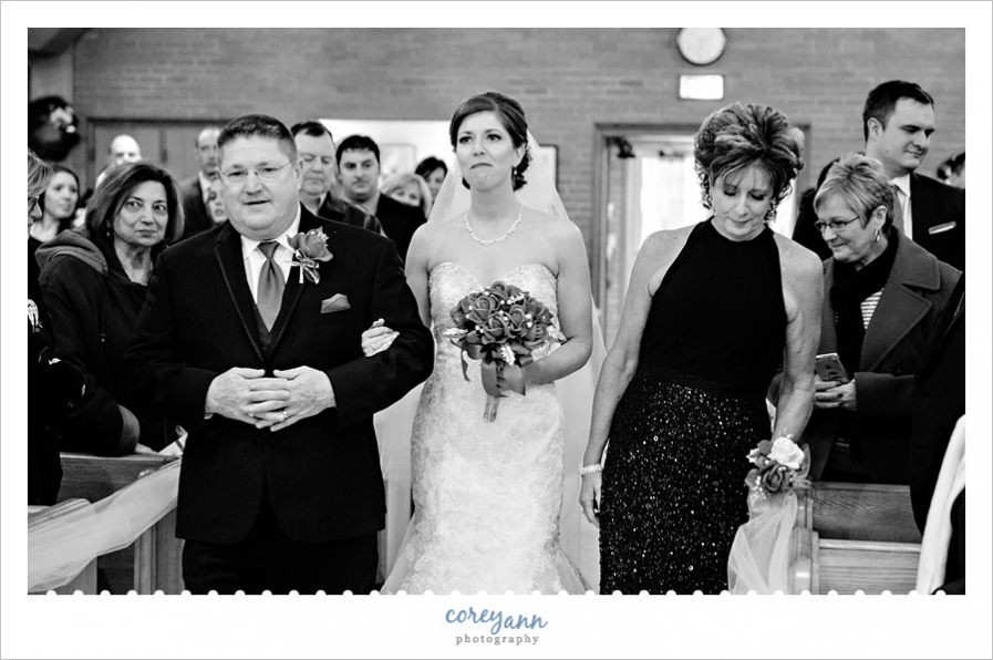 Bride and parents walking down aisle