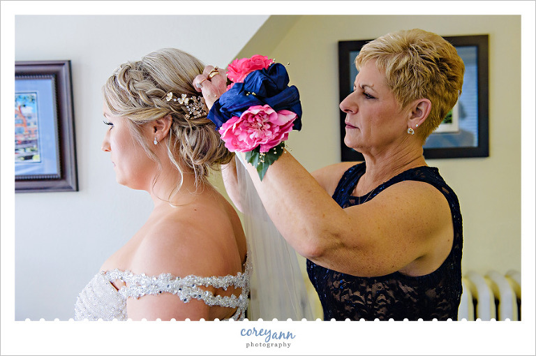Bride's Mother Pinning in Veil