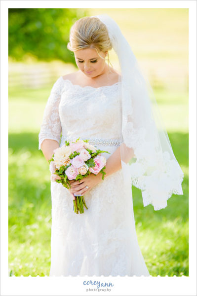 Bride in lace Oleg Cassini dress in Ohio