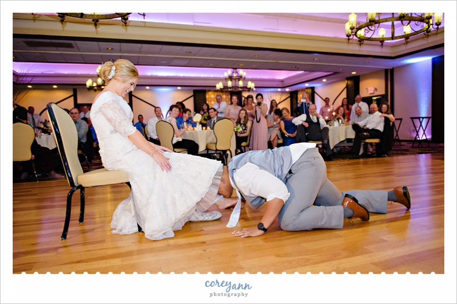 Garter removal at wedding reception