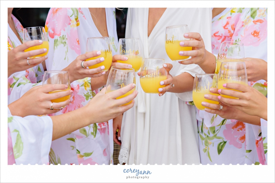 Wedding toast while getting ready with mimosas