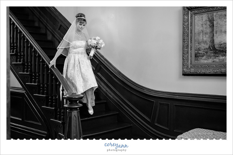 bride walking down stairs at steele mansion