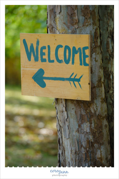 hand painted welcome sign to backyard wedding