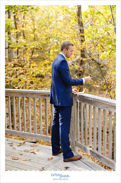 Groom reading letter before Virginia Wedding