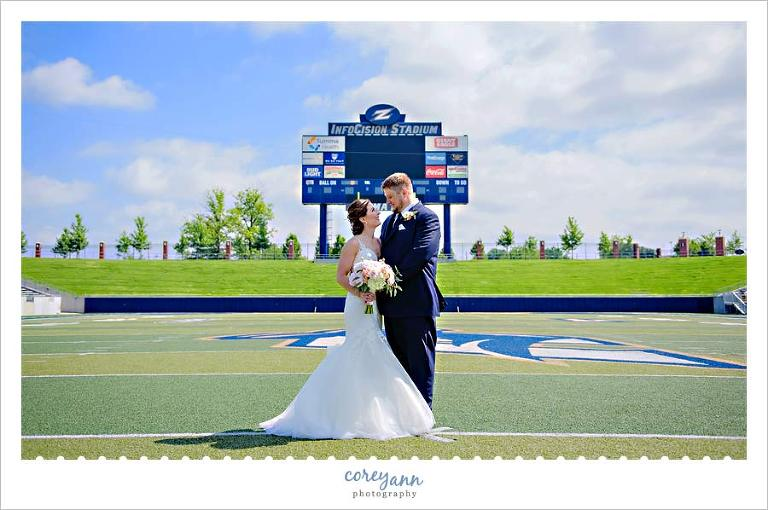 Summer wedding portrait at Infocsion Stadium at the University of Akron.