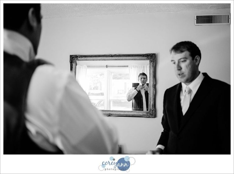 Groom getting ready for wedding in Stow Ohio